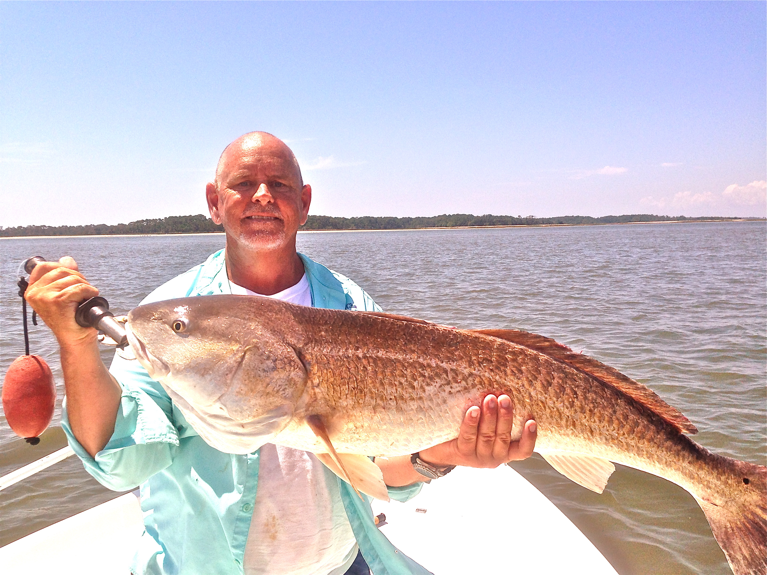 Capt. Jack on a sunny day with a large red drum!
