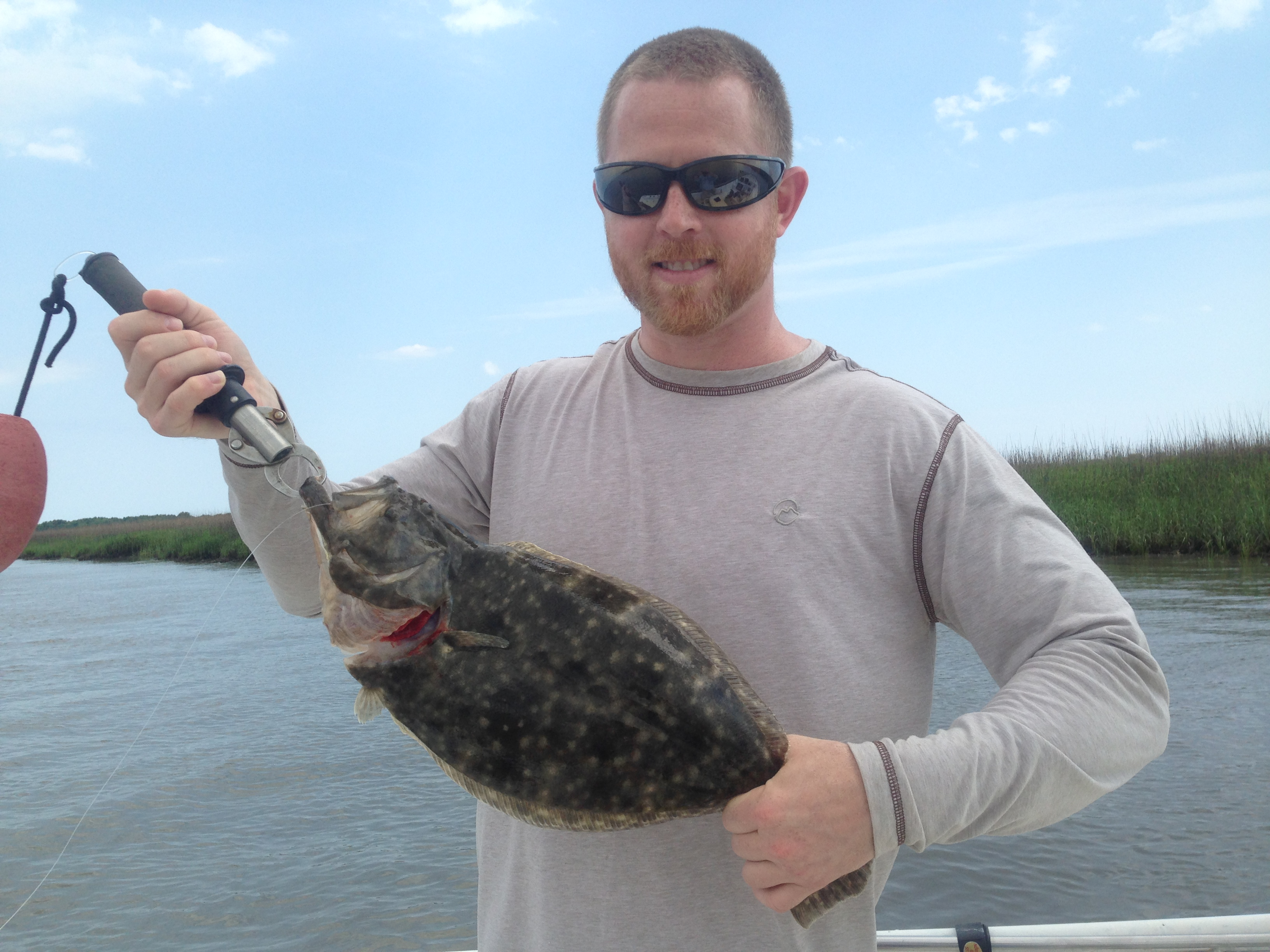 Corey Bowden catching flounder pitching jigs