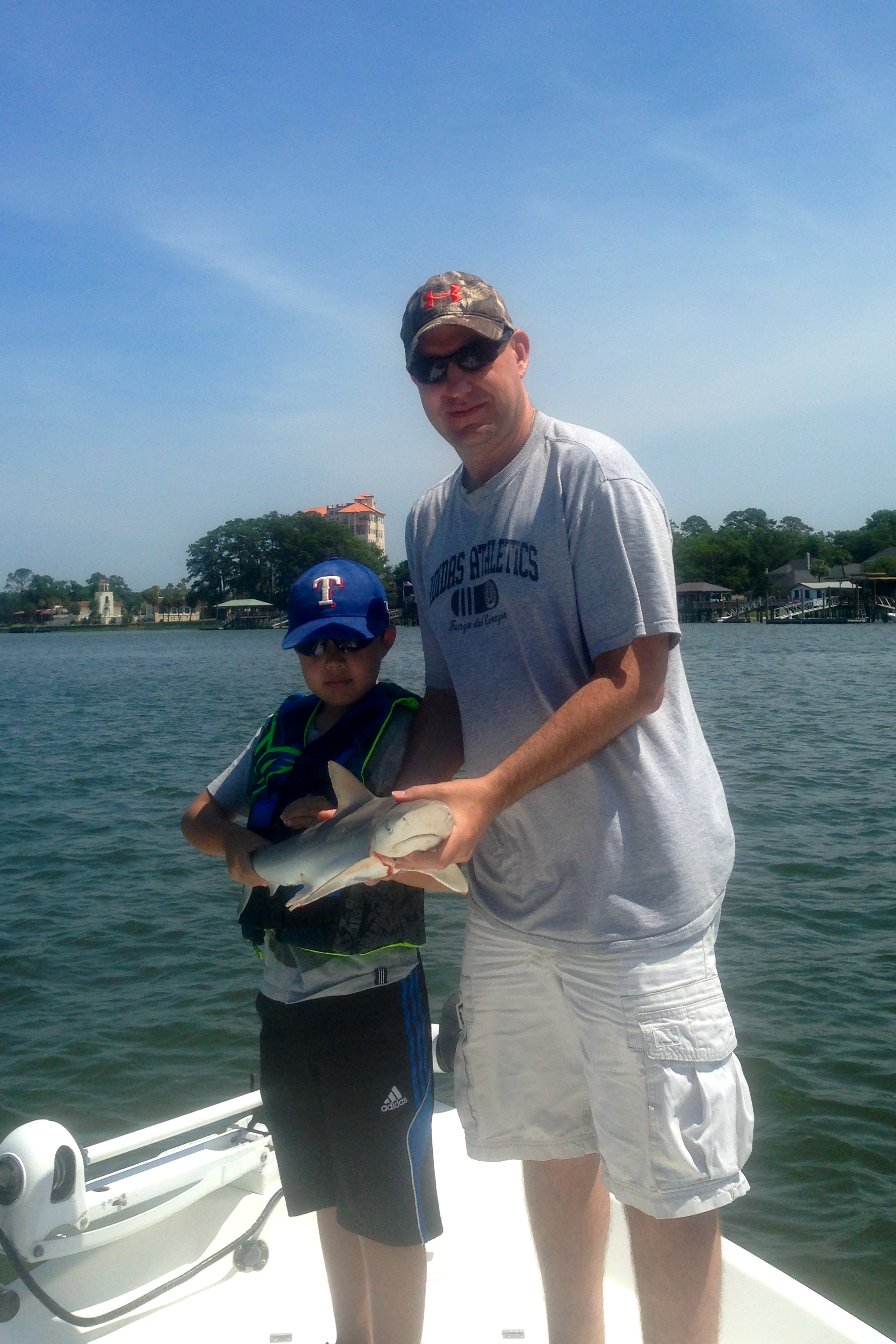 Daniel Myrick and his father Tony holding a nice Atlantic Sharp nose shark. The guys caught and released several.