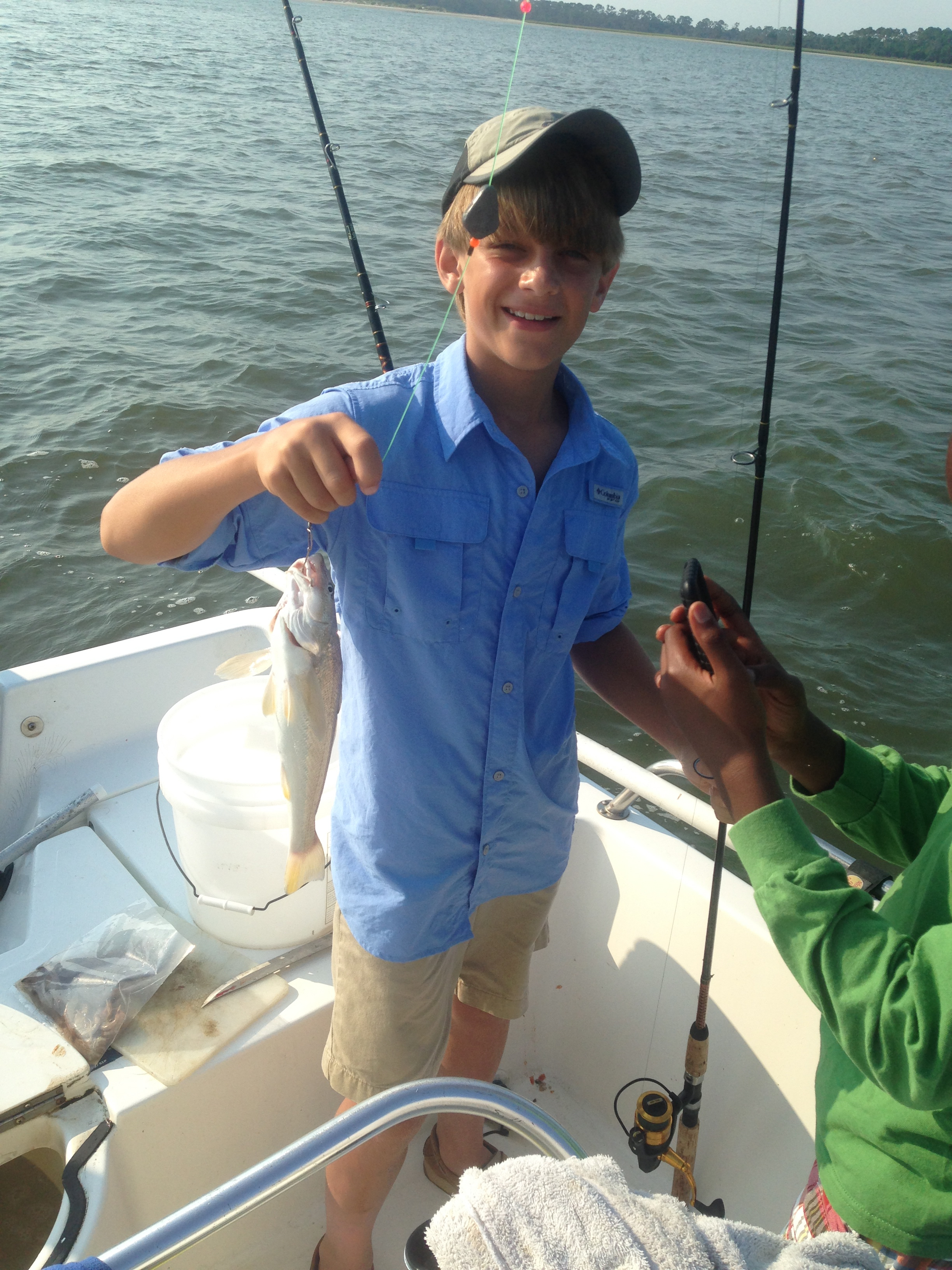 "Nate Manning and his Dad a friend Eric ""catching whiting"""