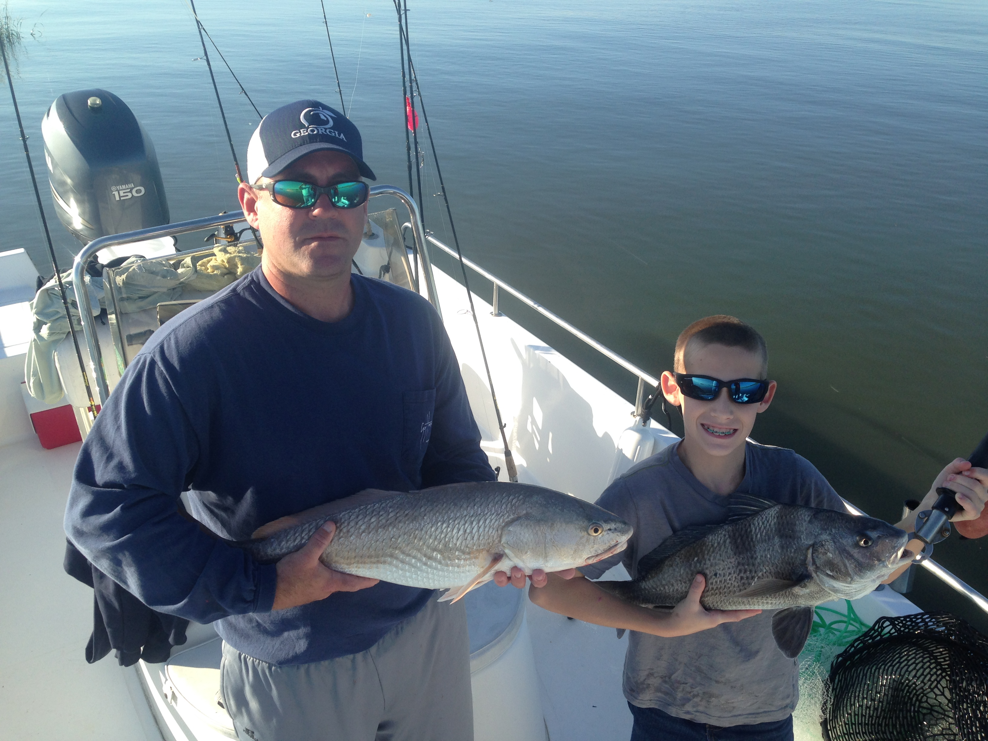 Michael Morris and son with a couple of nice fish! Michael has red while his son Christian is holding a black drum. Nice catching!