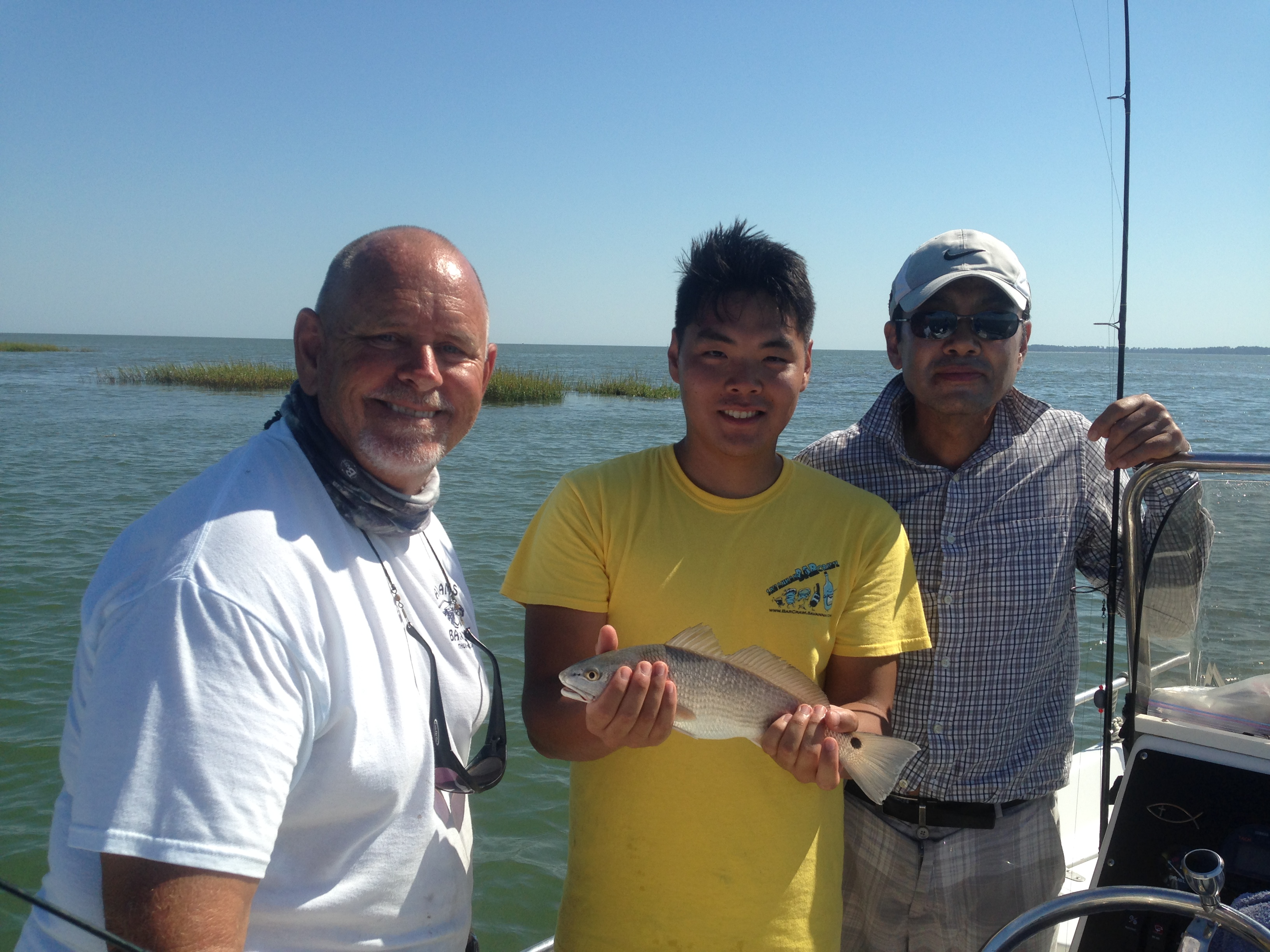 Capt. Jack and Peter Yoon with a schoolie red