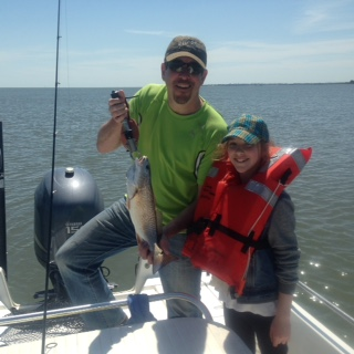 Dave Rubin and daughter Phoebe with a schoolie red.