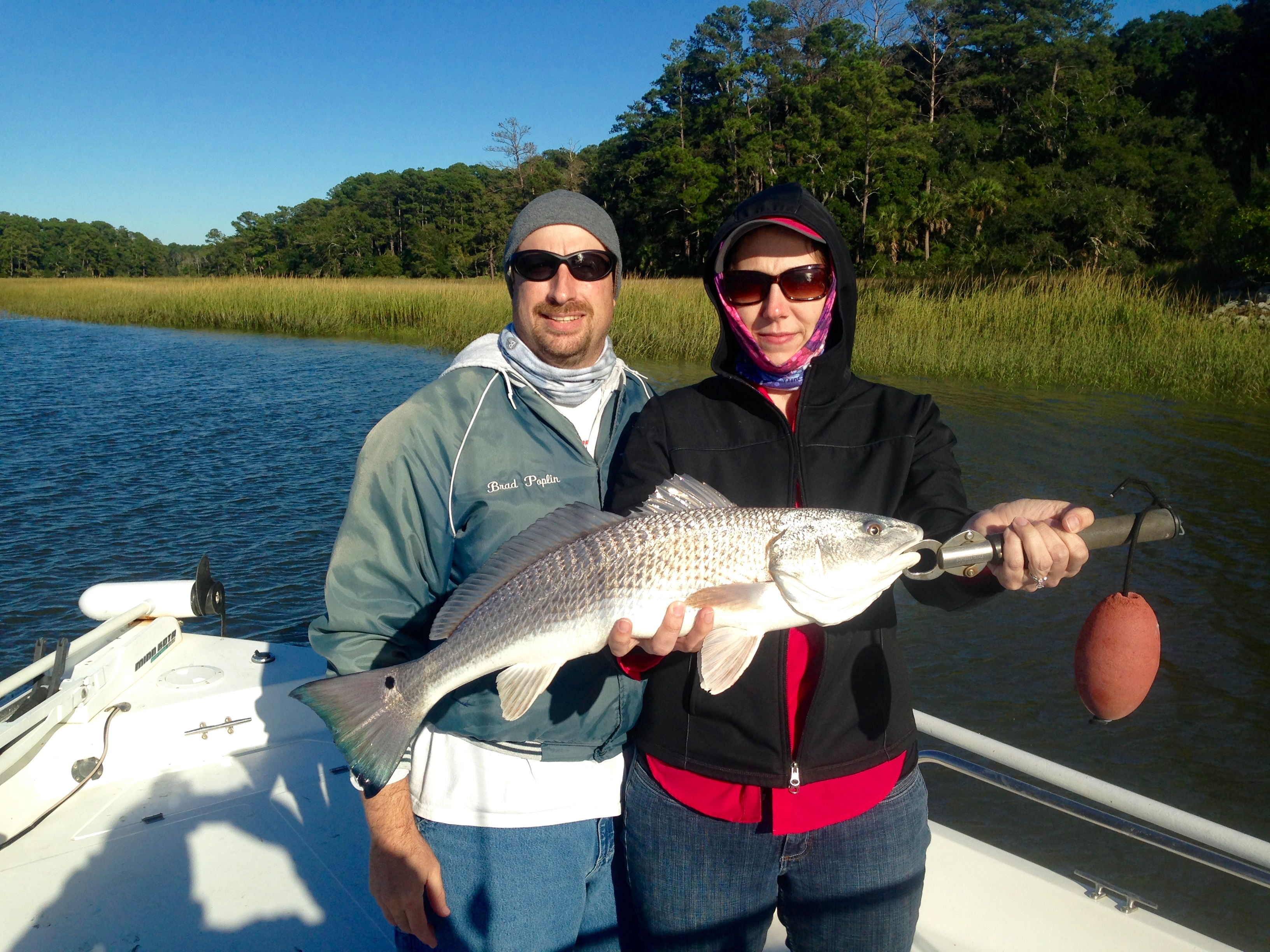 Brad and carol with a nice red coastal river charters for Tybee island fishing report
