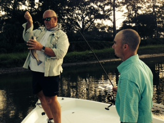 Capt Jack removing the jig from a schoolie redfish caught by Andy McCarthy