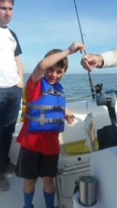 Ryder with a nice whiting! The whiting just starting to run!