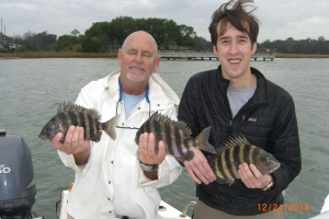 Capt Jack and Brain Mason (iron fist, velvet glove) catching sheepshead with his folks! Nice bite during changing weather!