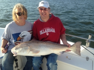 Brian Davalt & Trish Collins with a big red caught on dead shrimp! A near prefect day on the coast!
