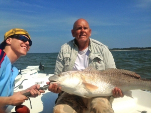 Richie Roberts and Capt. Jack with a large redfish Richie landed