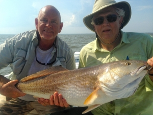 Capt. Jack and Peter Roberts with a large reddrum