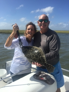 Donna Rooney with a nice flounder! Jim & Donna caught several schoolie reds on windy day with high tides.