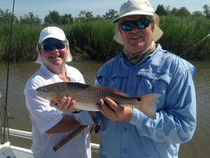 Michael Denmark and his Laird Miller catching some nice reds! Hot day but good fishing!