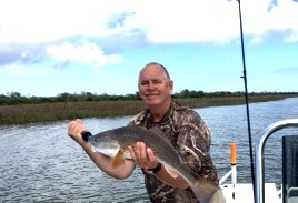 Capt.Jack with an afternoon redfish.