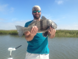 Chris catching and releasing a nice black drum!