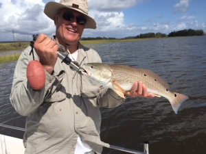 Dave Corral with 23 inch redfish. Dave caught & released a bunch of sea trout and some reds!