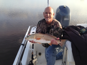 Capt. Jack with a nice late season redfish! At times during the winter these can be found schooling on the flats.