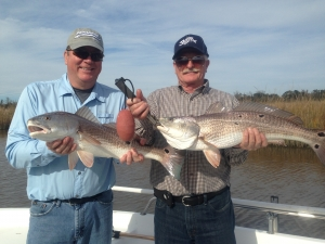 Steve and John Brooks doubling with a pair of over sized redfish!