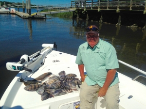 Tom Davis with a nice mess of sheepshead, red drum & lone flounder. Nice catch!