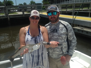 Tony and his wife with a nice seatrout she caught on a shrimp.
