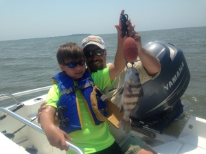 Michael & his dad John Michno with a chucky black drum! The boys caught several drum most a little shy of keeping size.