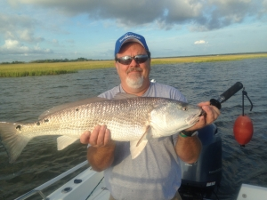 Kent with a 32 1/2 in. red! First redfish.