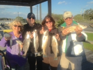 Gail, Mitch, Rose & Carl catching some reds and seatrout on a windy afternoon!