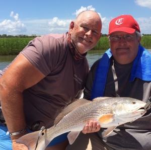 Dennis Loewer & Capt. Jack with a nice red!