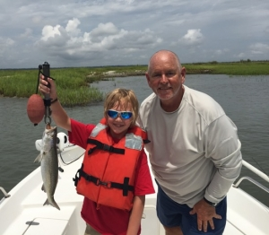 Grayson Binns and Capt. Jack. Grayson is holding a nice seatrout.