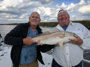 Capt. Jack & John Weathers with a 32 inch redfish.
