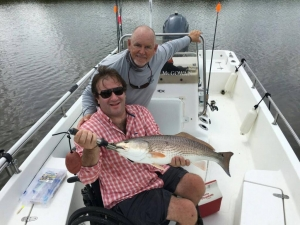 Robert with a large redfish! Pitching plastics for some reds!