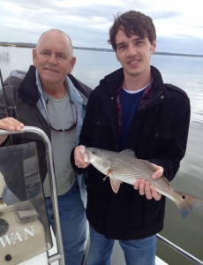 Capt Jack in background John Wilson with an 18 inch redfish caught on a mud minnow under a DOA popping cork. High tides and slow fishing.