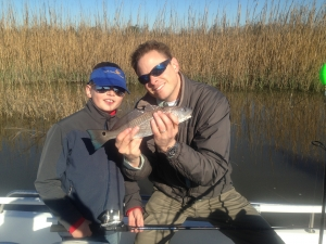 Davis Garrison and his Dad with a schoolie red Davis caught