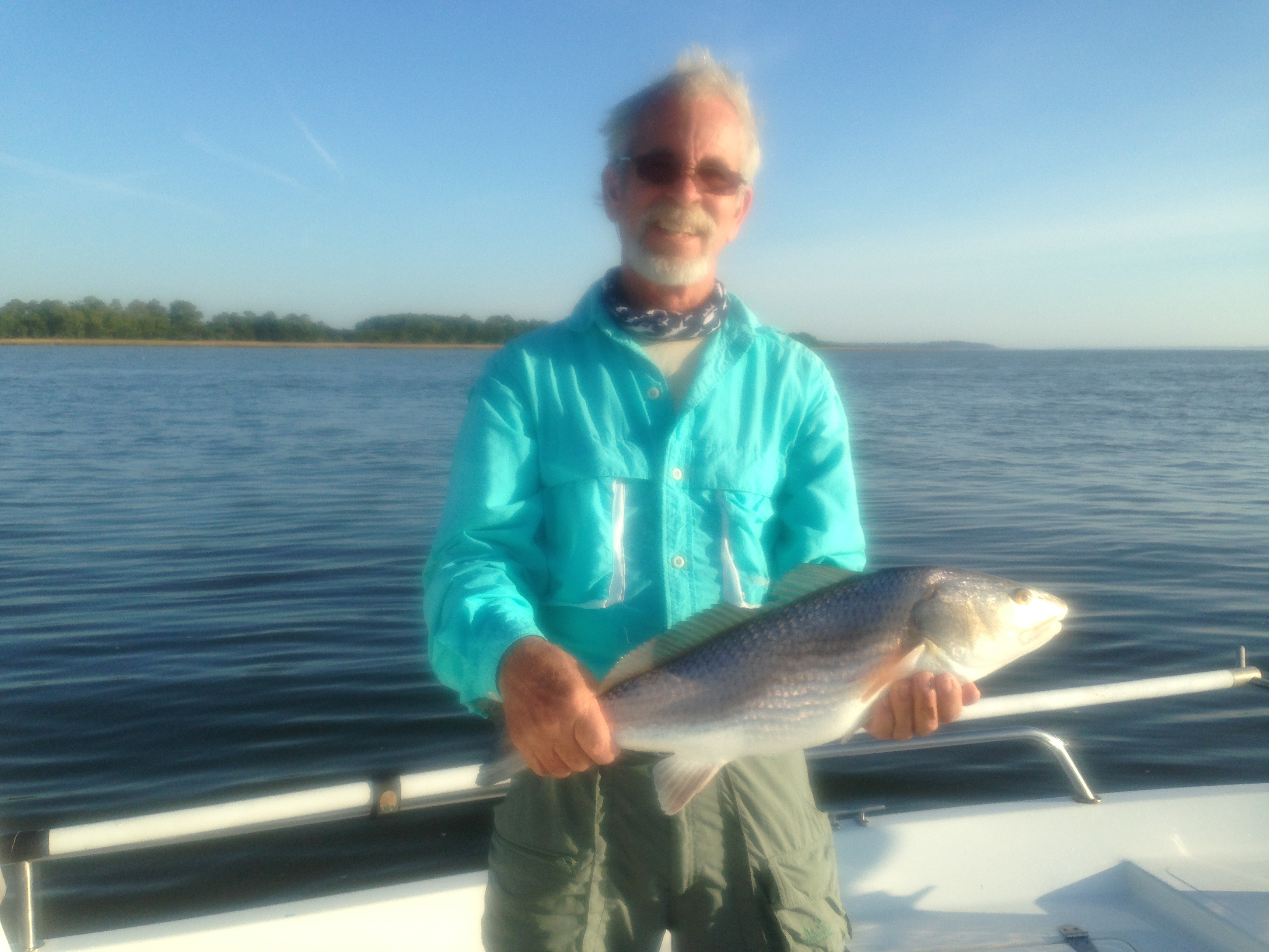 Ron Thomas taking a seldom morning off catching some nice seatrout and redfish with Capt. Jack