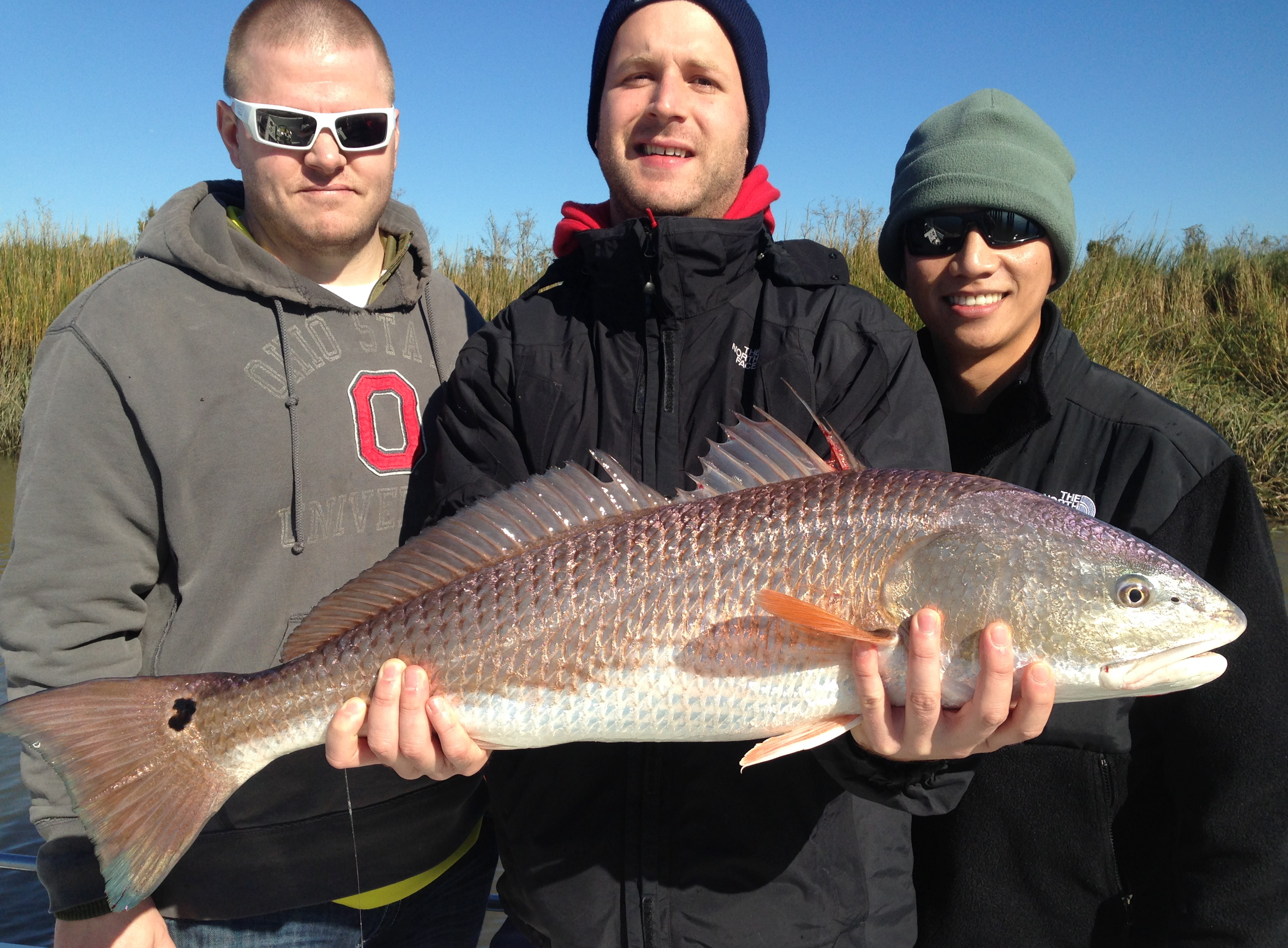 Marcus Ortman. Alexander Perkins and Lam Hoang with a large red! Dandy fish!