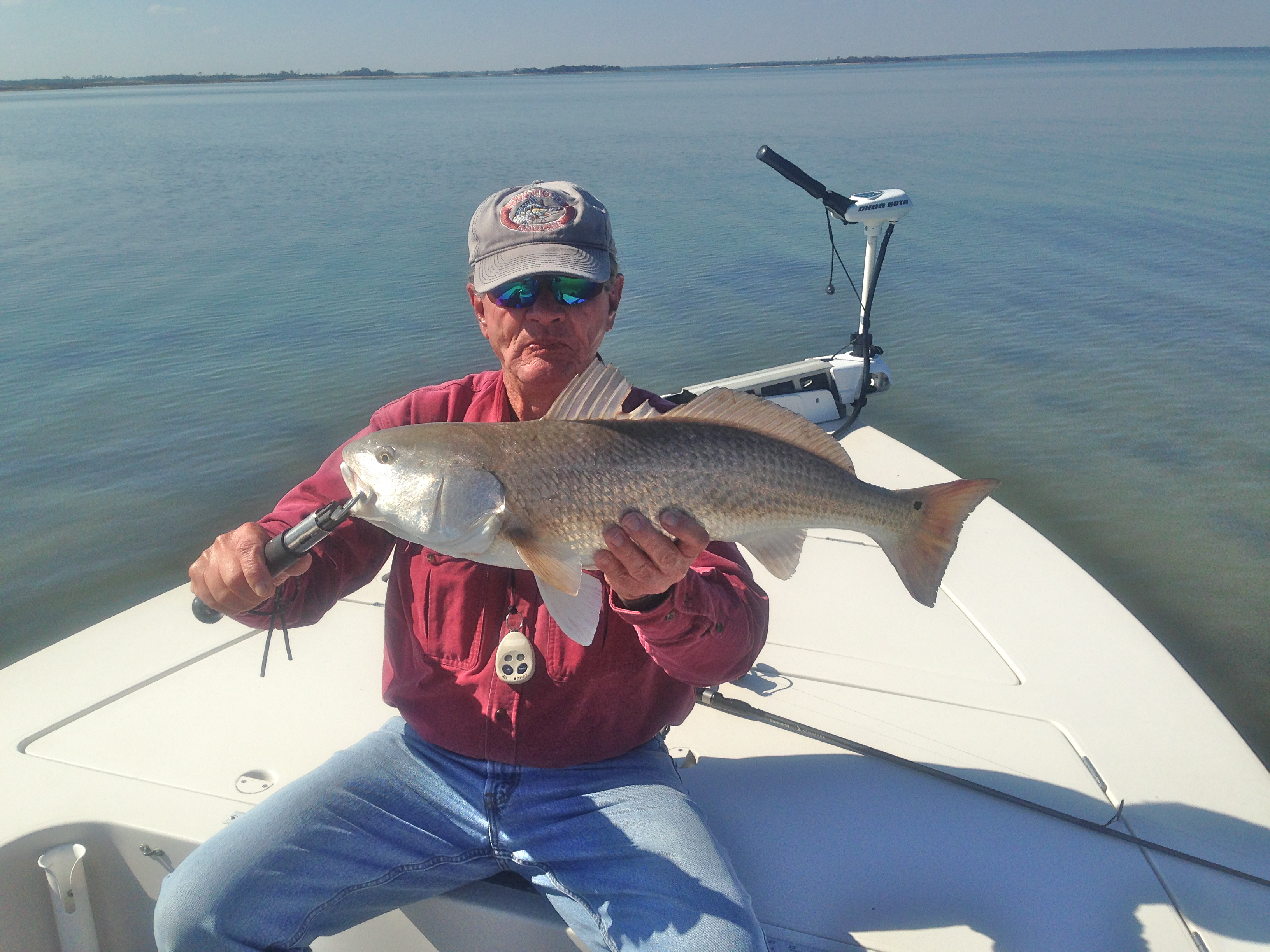 Capt.Ray showing off a nice winter red