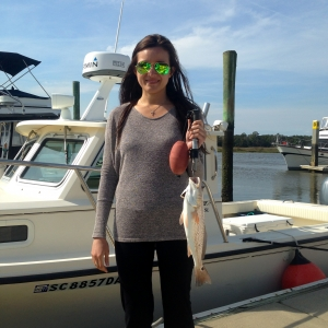 Alexandria and her parents fishing Robert and Rua Law doing some inshore fishing. Here's Alexandria with a schoolie red.