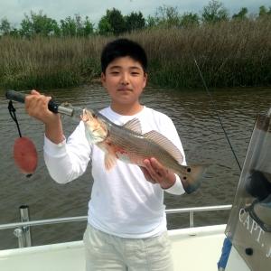 Chris Hirata catching some nice schoolie reds!